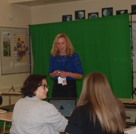 Video production in the elementary classroom - teacher Ellen Kraska demonstrates use of a green screen in a professional development activity for other teachers (photo by Tabitha Kappeler Hurley, used by permission)