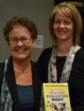 Linda Darling-Hammond (L), and Shanan Brown, with a copy of Darling-Hammond's book on teacher evaluation.